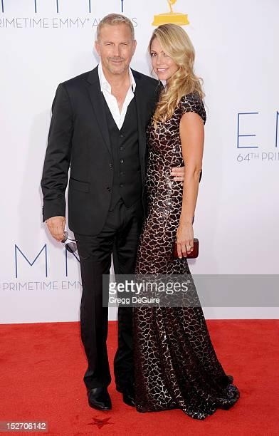 Actor Kevin Costner and wife Christine Baumgartner arrive at the 64th Primetime Emmy Awards at Nokia Theatre LA Live on September 23 2012 in Los...