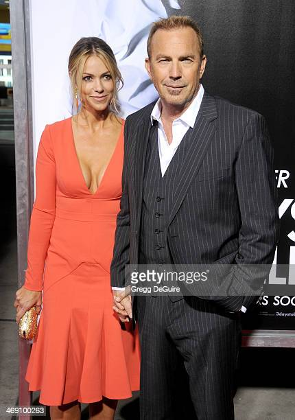 Actor Kevin Costner and wife Christine Baumgartner arrive at the Los Angeles premiere of 3 Days To Kill at ArcLight Cinemas on February 12 2014 in...
