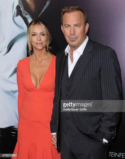 Actor Kevin Costner and wife Christine Baumgartner arrive at the Los Angeles premiere of '3 Days to Kill' at ArcLight Cinemas on February 12 2014 in...