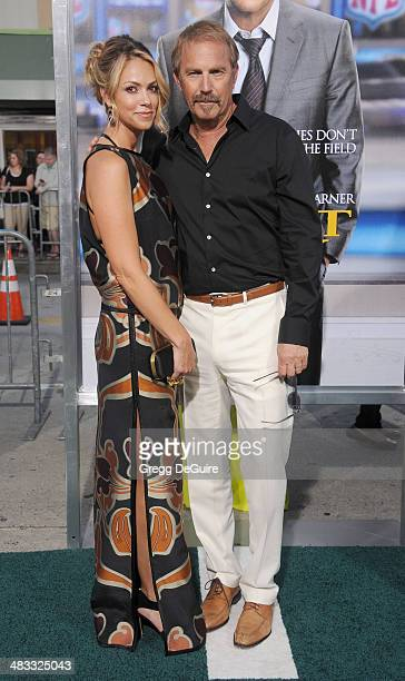 Actor Kevin Costner and wife Christine Baumgartner arrive at the Los Angeles premiere of Draft Day at Regency Village Theatre on April 7 2014 in...