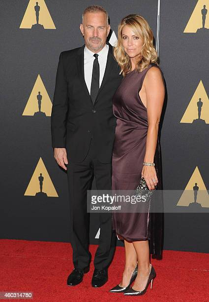 Actor Kevin Costner and wife Christine Baumgartner arrive at the Academy Of Motion Picture Arts And Sciences' Governors Awards at The Ray Dolby...