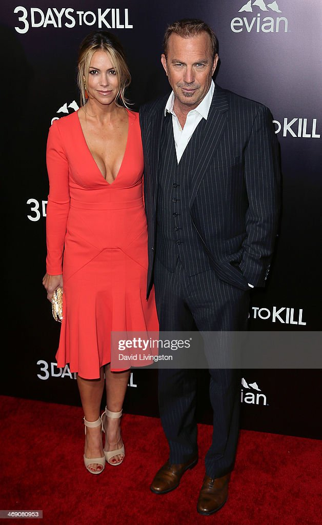 Actor Kevin Costner (R) and wife Christine Baumgartner attend the premiere of Relativity Media's '3 Days to Kill' at ArcLight Cinemas on February 12, 2014 in Hollywood, California.