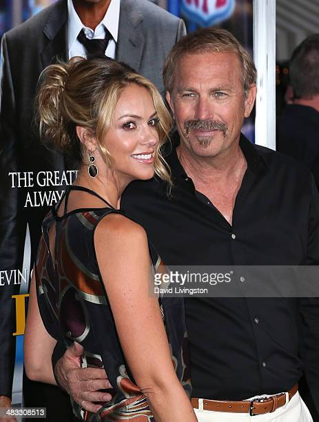 Actor Kevin Costner and wife Christine Baumgartner attend the premiere of Summit Entertainment's Draft Day at the Regency Village Theatre on April 7...