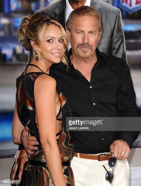 Actor Kevin Costner and wife Christine Baumgartner attend the premiere of Draft Day at Regency Bruin Theatre on April 7 2014 in Los Angeles California