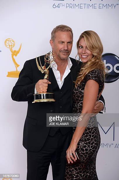 Actor Kevin Costner and wife Christine Baumgartner pose in the press room at the 64th annual Prime Time Emmy Awards at the Nokia Theatre at LA Live...
