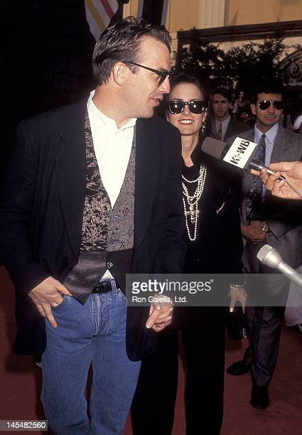 Actor Kevin Costner and wife Cindy Costner attend the Robin Hood Prince of Thieves Westwood Premiere on June 10 1991 at the Mann Village and Bruin...