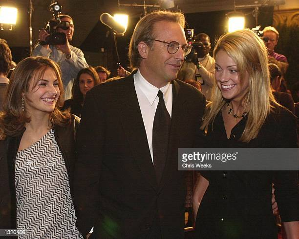 Actor Kevin Costner center his daughter Annie left and girlfriend Christine Baumgartner right arrive at the premiere of New Line Cinema''s 'Thirteen...