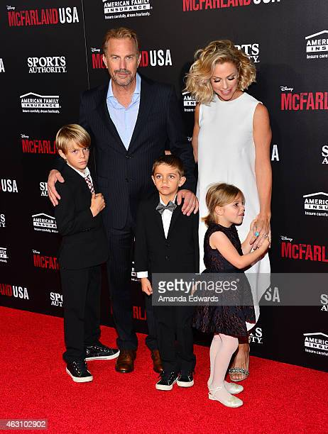 Actor Kevin Costner his wife Christine Baumgartner and their children arrive at the world premiere of Disney's McFarland USA at the El Capitan...