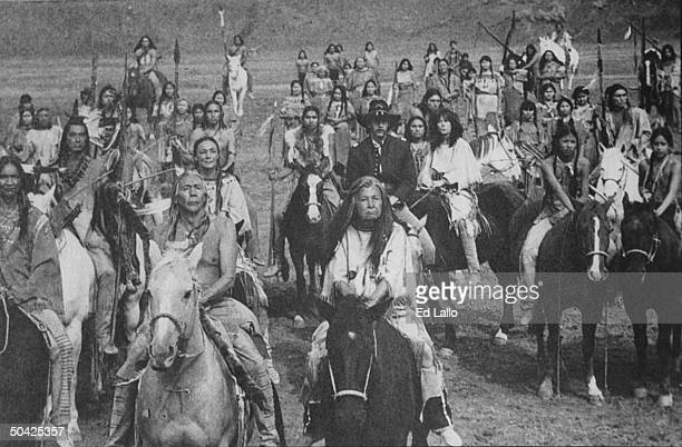 Actor Kevin Costner in hat & military uniform riding w. Group of Lakota Sioux Indians lead by actress Doris Leader Charge as chief's wife Pretty...