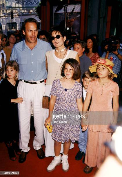 Actor Kevin Costner poses for a portrait with his exwife and children Cindy Costner Annie Lily and Joe arrive for the 'Wyatt Earp' Hollywood Premiere...