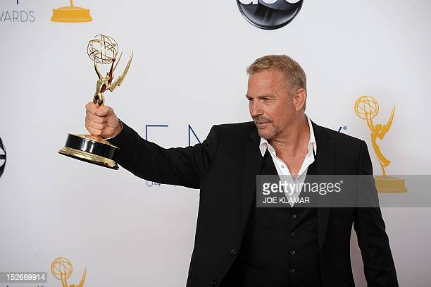 Actor Kevin Costner poses in the press room at the 64th annual Prime Time Emmy Awards at the Nokia Theatre at LA Live in Los Angeles, California...
