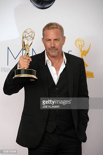 Actor Kevin Costner poses in the press room at the 64th annual Prime Time Emmy Awards at the Nokia Theatre at LA Live in Los Angeles California...