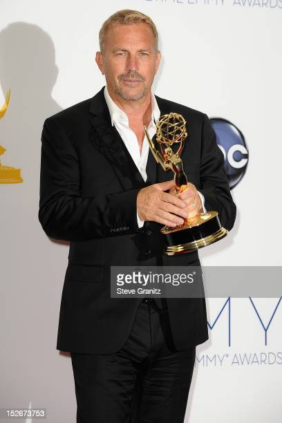 Actor Kevin Costner poses in the press room of the 64th Primetime Emmy Awards at Nokia Theatre LA Live on September 23 2012 in Los Angeles California