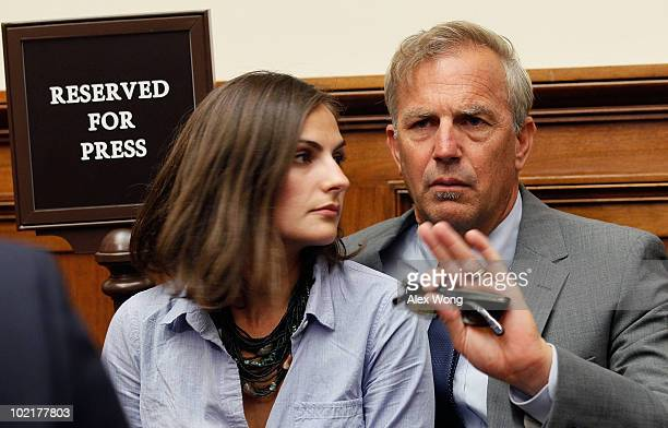 Actor Kevin Costner sits with his daughter Annie Costner while listening to BP Chief Executive Tony Hayward testify before the Oversight and...
