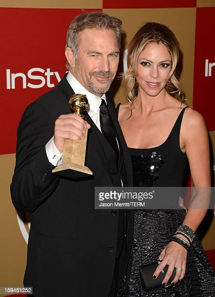 Actor Kevin Costner winner of Best Actor in a MiniSeries or a Motion Picture Made for Television for Hatfields McCoys and Christine Baumgartner...