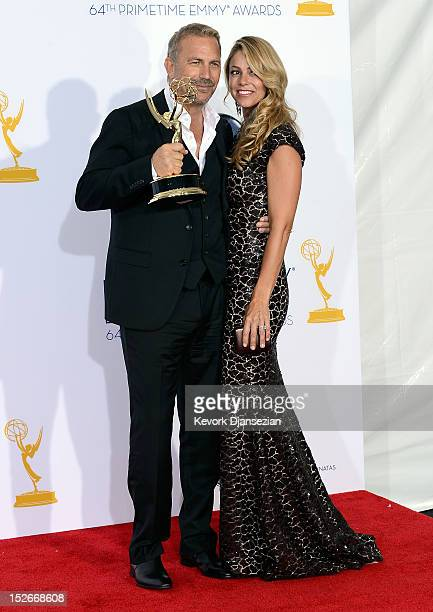 Actor Kevin Costner winner Outstanding Lead Actor in a Miniseries or a Movie for 'Hatfields McCoys' poses in the press room with wife Christine...