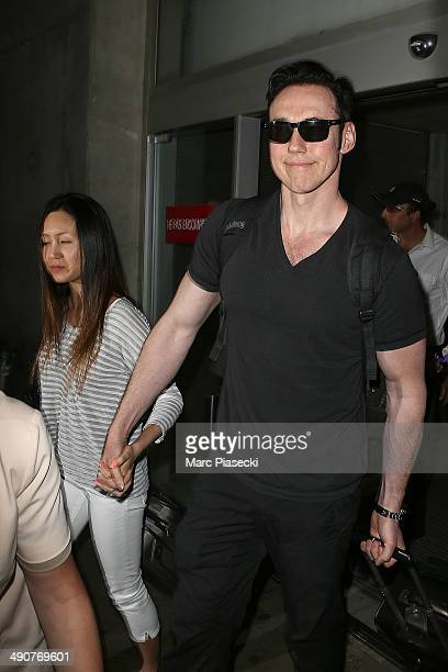 Actor Kevin Durand and wife Sandra Cho arrive in Nice for the 67th Annual Cannes Film Festival on May 15 2014 in Nice France