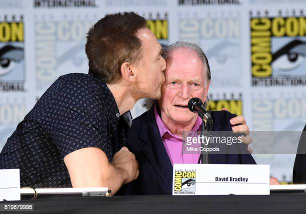 Actor Kevin Durand kisses actor David Bradley onstage at 'The Strain' screening and QA during ComicCon International 2017 at San Diego Convention...