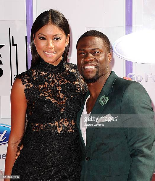 Actor Kevin Hart and Eniko Parrish attend the 2014 BET Awards at Nokia Plaza LA LIVE on June 29 2014 in Los Angeles California