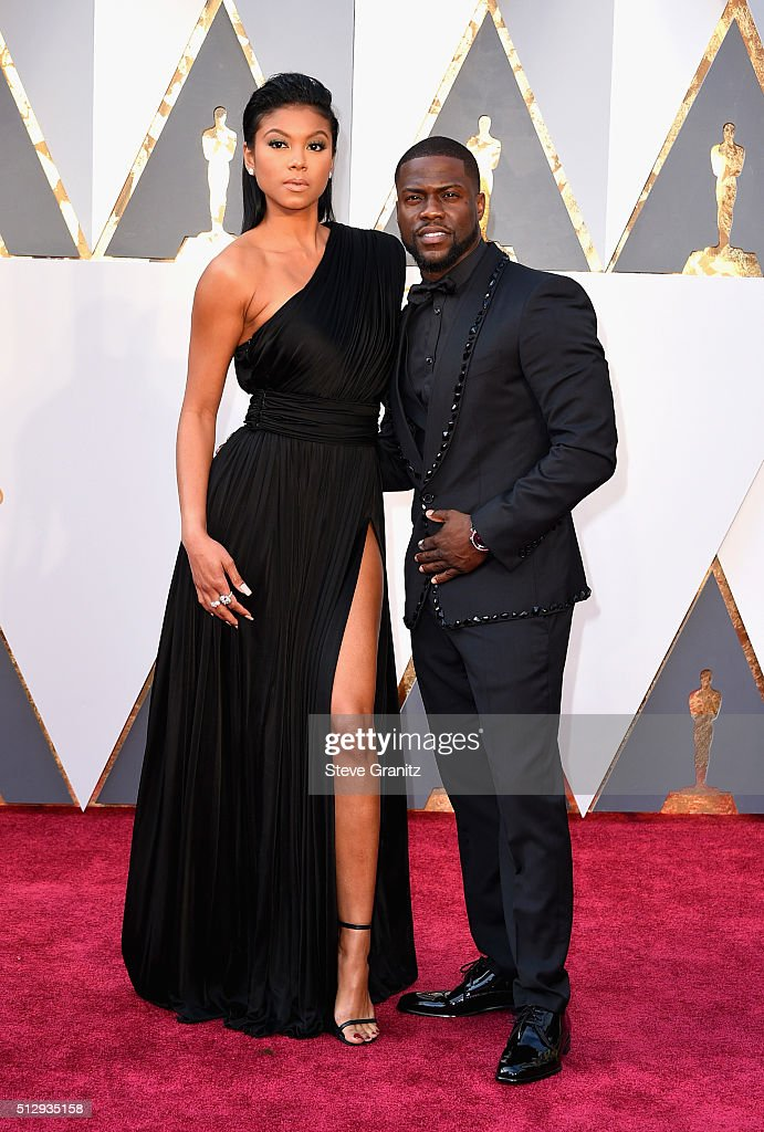 Actor Kevin Hart (R) and Eniko Parrish attend the 88th Annual Academy Awards at Hollywood & Highland Center on February 28, 2016 in Hollywood, California.