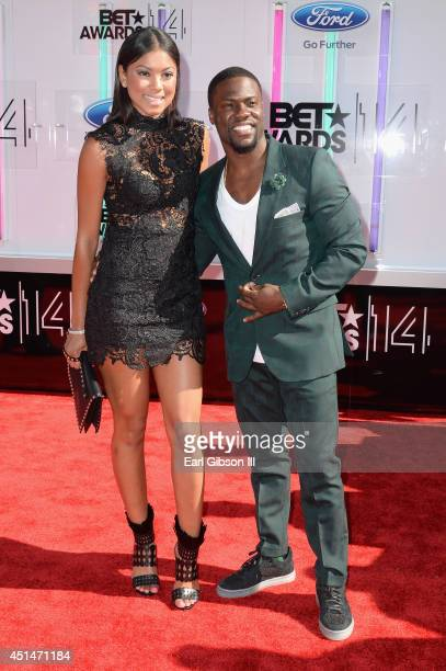 Actor Kevin Hart and Eniko Parrish attend the BET AWARDS '14 at Nokia Theatre LA LIVE on June 29 2014 in Los Angeles California