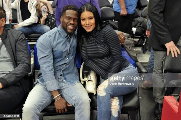 Actor Kevin Hart and Eniko Parrish attends a basketball game between the Los Angeles Clippers and the Minnesota Timberwolves at Staples Center on...