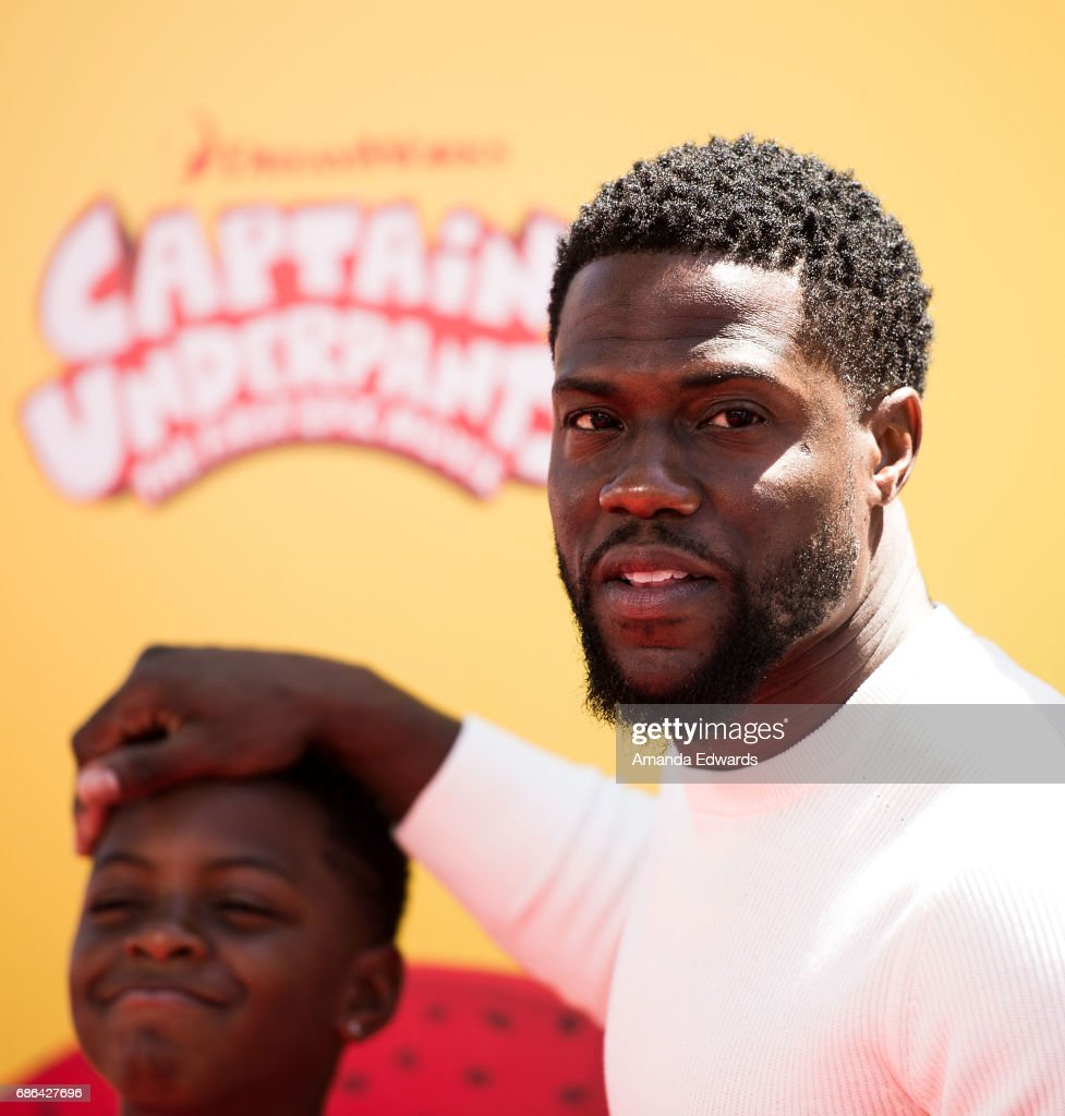 Actor Kevin Hart (R) and his son Hendrix Hart arrive at the premiere of 20th Century Fox's 'Captain Underpants: The First Epic Movie' at the Regency Village Theatre on May 21, 2017 in Westwood, California.