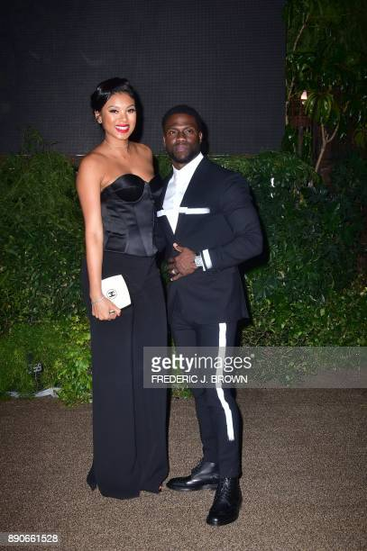 Actor Kevin Hart and his wife Eniko Parrish arrive for the premiere of Jumanji Welcome to the Jungle in Hollywood California on December 11 2017 /...