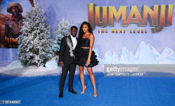 US actor Kevin Hart and his wife Eniko Parrish arrive for the World Premiere of Jumanji The Next Level at the TCL Chinese theatre in Hollywood on...
