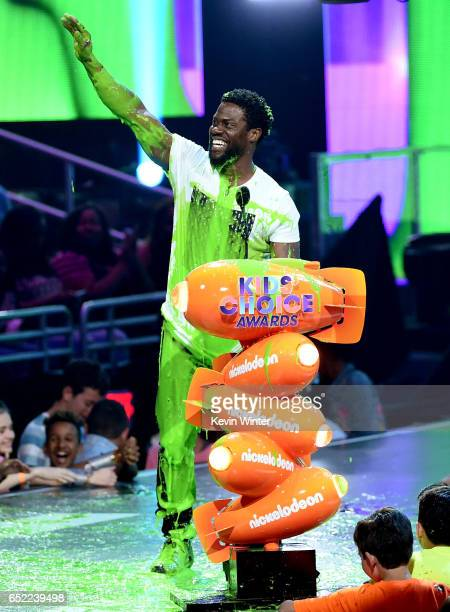 Actor Kevin Hart gets slimed onstage at Nickelodeon's 2017 Kids' Choice Awards at USC Galen Center on March 11 2017 in Los Angeles California