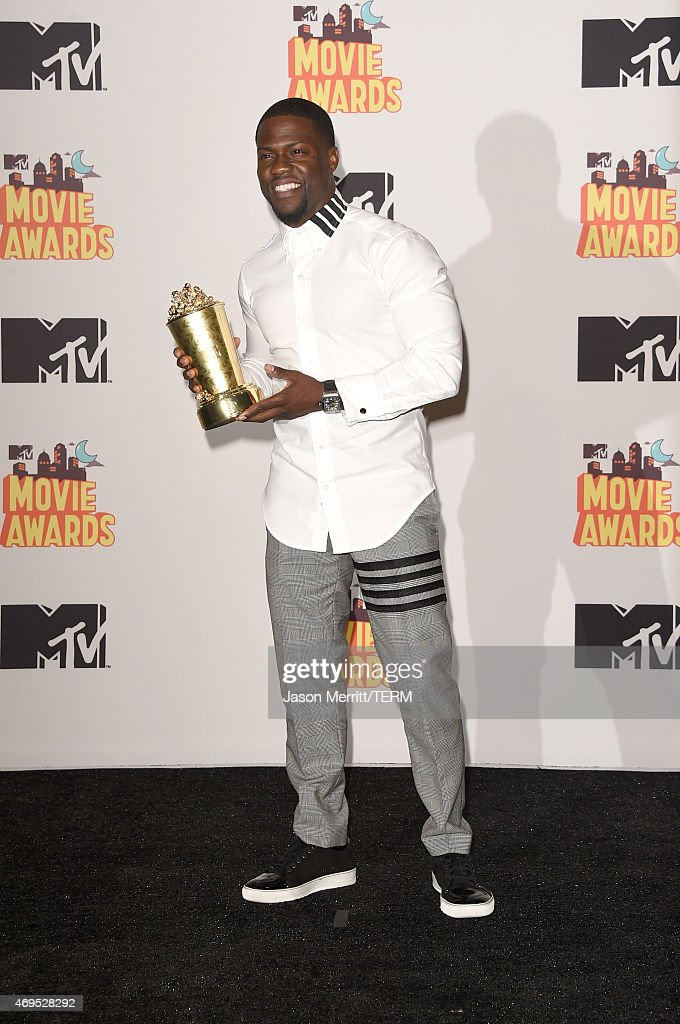 Actor Kevin Hart, winner of the Comedic Genius Award, poses in the press room during The 2015 MTV Movie Awards at Nokia Theatre L.A. Live on April 12, 2015 in Los Angeles, California.