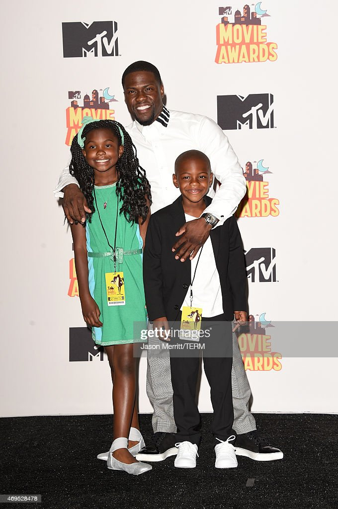Actor Kevin Hart (C), winner of the Comedic Genius Award, poses with Heaven Hart (L) and Hendrix Hart (R) in the press room during The 2015 MTV Movie Awards at Nokia Theatre L.A. Live on April 12, 2015 in Los Angeles, California.