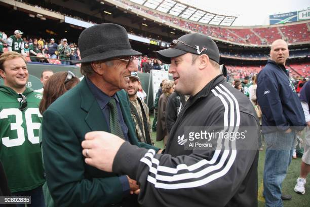 Actor Kevin James meets former New York Jets Quarterback Joe Namath on the sideline before the game when the New York Jets host the Miami Dolphins at...