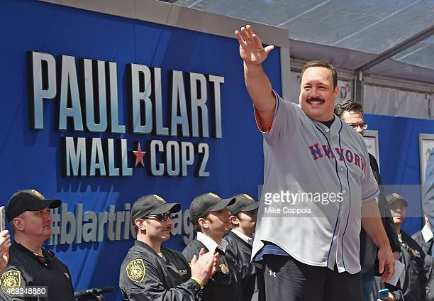 Actor Kevin James waves to the crowd after he arrives for the 'Paul Blart Mall Cop 2' New York Premiere at AMC Loews Lincoln Square on April 11 2015...