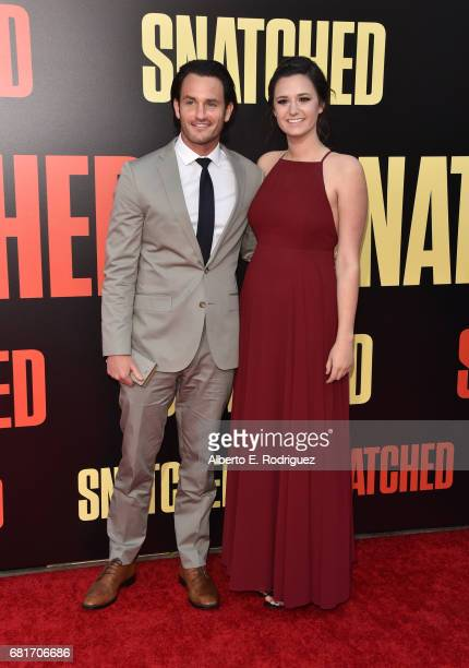 Actor Kevin Kane and guest attend the premiere of 20th Century Fox's Snatched at Regency Village Theatre on May 10 2017 in Westwood California