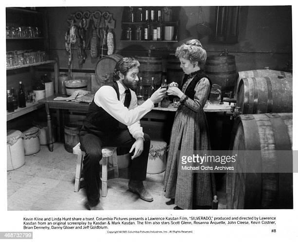 Actor Kevin Kline and actress Linda Hunt on set the movie Silverado circa 1985