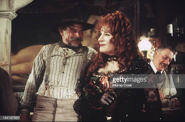 Actor Kevin Kline as Artemus Gordon with Buck Taylor as CrossEyed Reb on the set of the film 'Wild Wild West' 29th May 1998