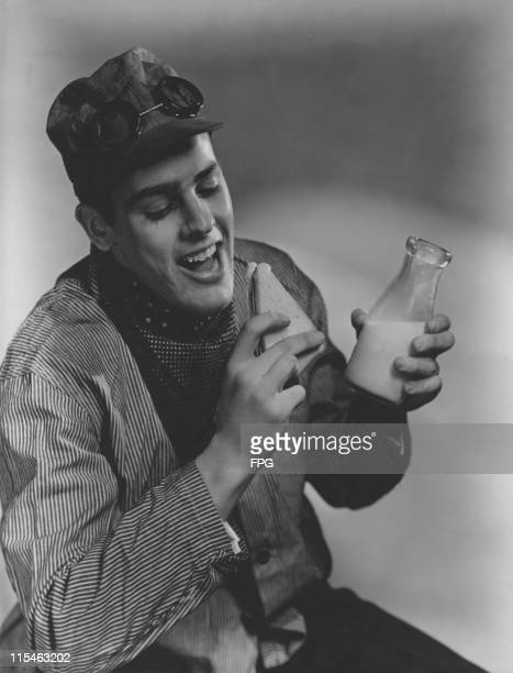 US actor Kevin McCarthy poses holding a milk bottle and a sandwich in a publicity still from an identified film circa 1945