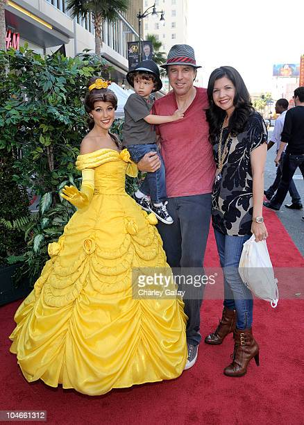Actor Kevin Nealon actress Susan Yeagley and son Gable Ness Nealon pose with Belle at Walt Disney Studios Beauty and The Beast SingAlong at the El...
