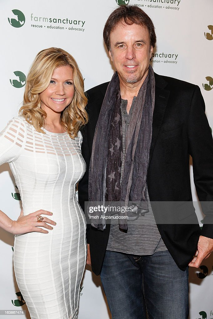 Actor Kevin Nealon (R) and actress Susan Yeagley attend the Fun For Animals Celebrity Poker Tournament & Cocktail Party at Petersen Automotive Museum on March 16, 2013 in Los Angeles, California.