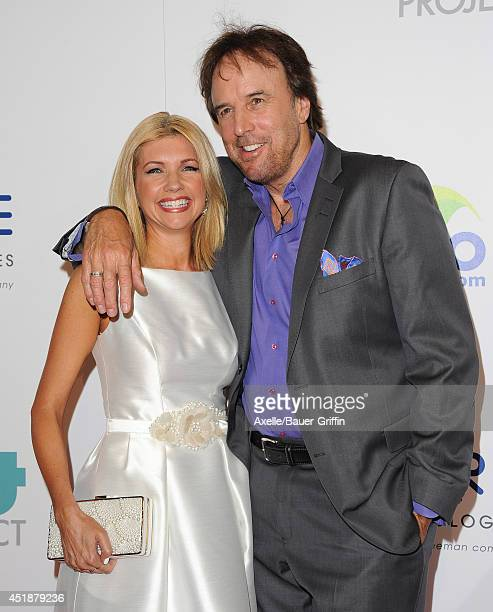 Actor Kevin Nealon and wife Susan Yeagley arrive at the 5th Annual Thirst Gala at The Beverly Hilton Hotel on June 24 2014 in Beverly Hills California
