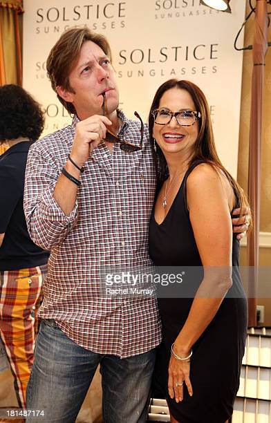 Actor Kevin Rahm in Carrera 6000 sunglasses poses with Director of Public Relations Solstice Sunglasses/Safilo Eden Wexler at the Solstice Sunglasses...