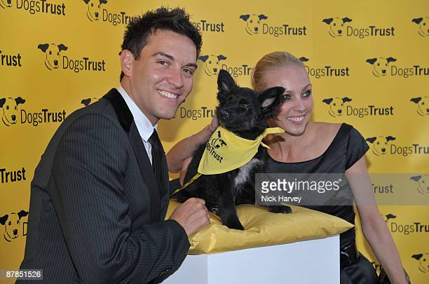 Actor Kevin Sacre and professional dancer Camilla Dallerup pose with Fluffles the dog during the Dogs Trust Honours 2009 at The Hurlingham Club on...