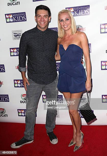 "Actor Kevin Sacre and wife ballroom dancer Camilla Dallerup attend the ""Music On A Mission"" benefit concert presented by Mending Kids at Lucky Strike..."