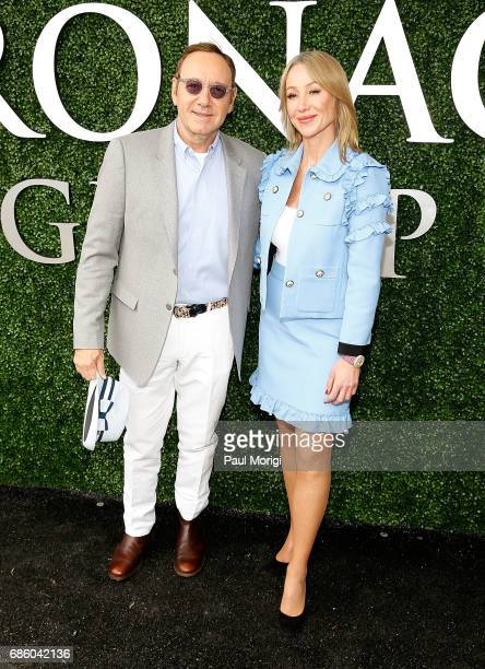 Actor Kevin Spacey and Chairman and President of The Stronach Group Belinda Stronach arrive at The Stronach Group Owner's Chalet at 142nd Preakness...