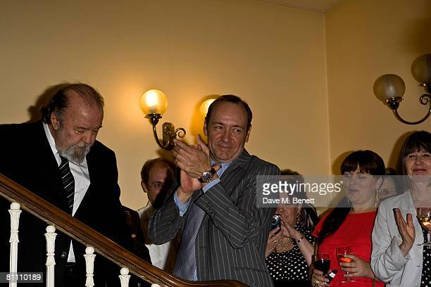 Actor Kevin Spacey applauds beside director Sir Peter Hall during the after party for the performance of 'Pygmalion' directed by Sir Peter Hall and...