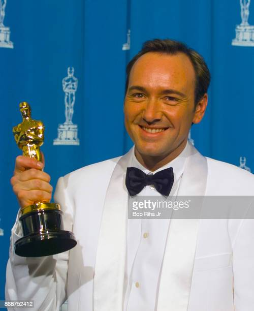 Actor Kevin Spacey holds his Oscar award for Best Supporting Actor for his role in 'The Usual Suspects' March 25 1996 in Los Angeles California