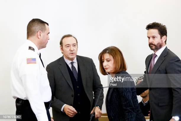 Actor Kevin Spacey is escorted with his lawyers Juliane Baliro and Alan Jackson during his arraignment for sexual assault charges at Nantucket...