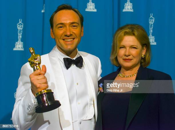 Actor Kevin Spacey poses backstage with his mother Kathleen and his Oscar for Best Supporting Actor for his role in 'The Usual Suspects' March 25...