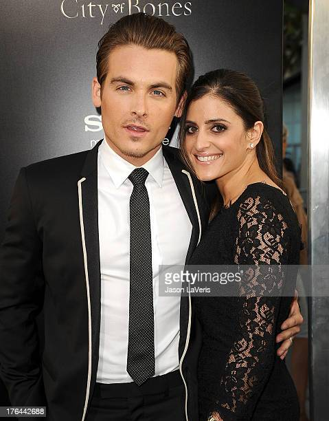 Actor Kevin Zegers and wife Jaime Feld attend the premiere of 'The Mortal Instruments City Of Bones' at ArcLight Cinemas Cinerama Dome on August 12...